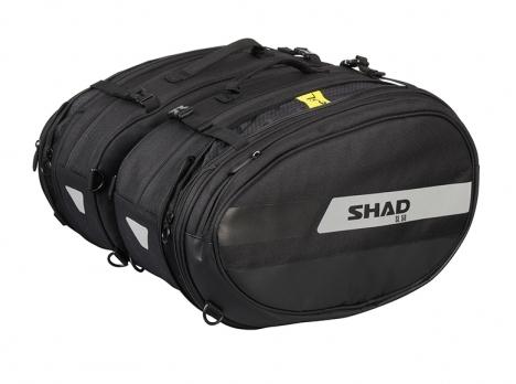 Alforjas laterales moto Shad SL58 con capacidad extensible de 46L a 58L.